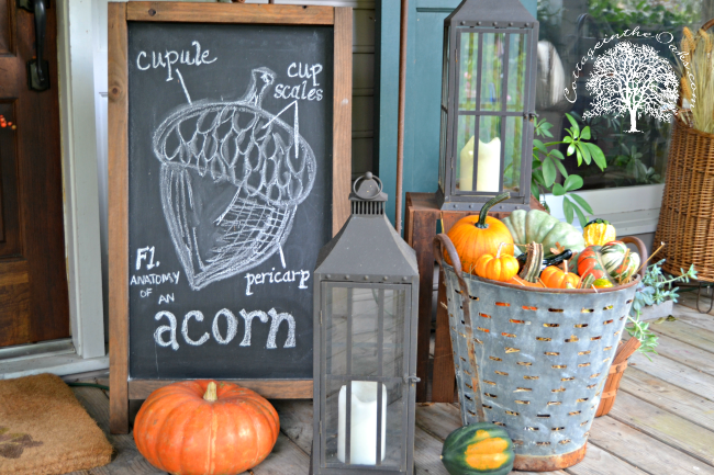Chalkboard, olive bucket, pumpkins on the porch for fall